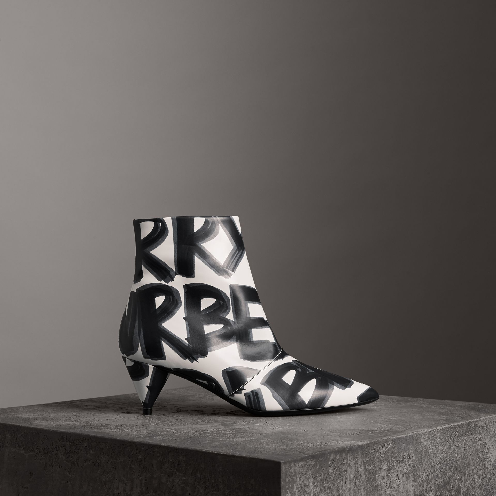 Graffiti Print Leather Ankle Boots in Optic White - Women | Burberry Canada - gallery image 0