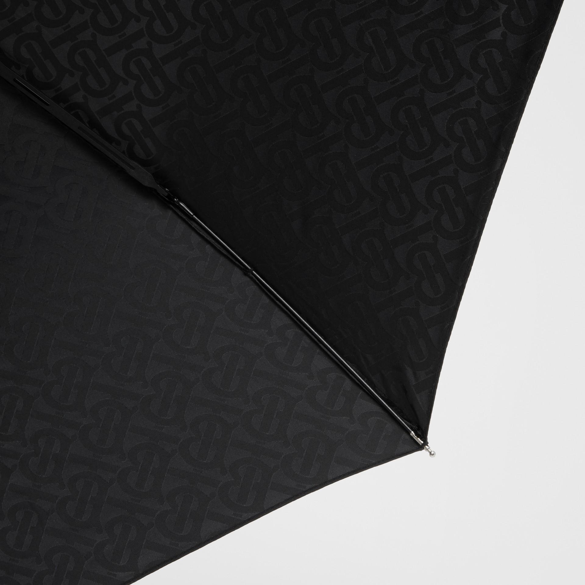 Monogram Print Folding Umbrella in Black | Burberry - gallery image 1