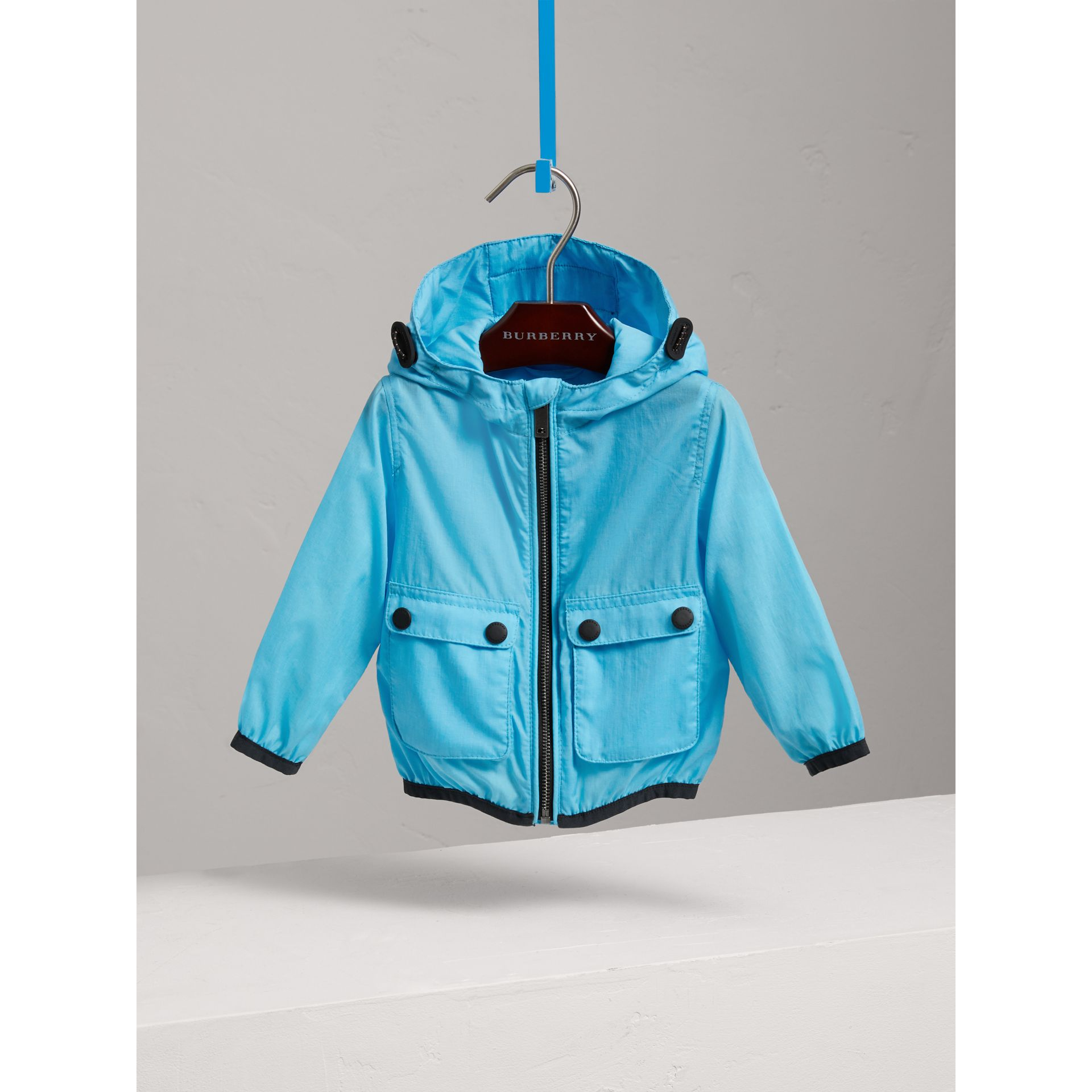 Showerproof Hooded Jacket in Bright Turquoise - Children | Burberry - gallery image 0