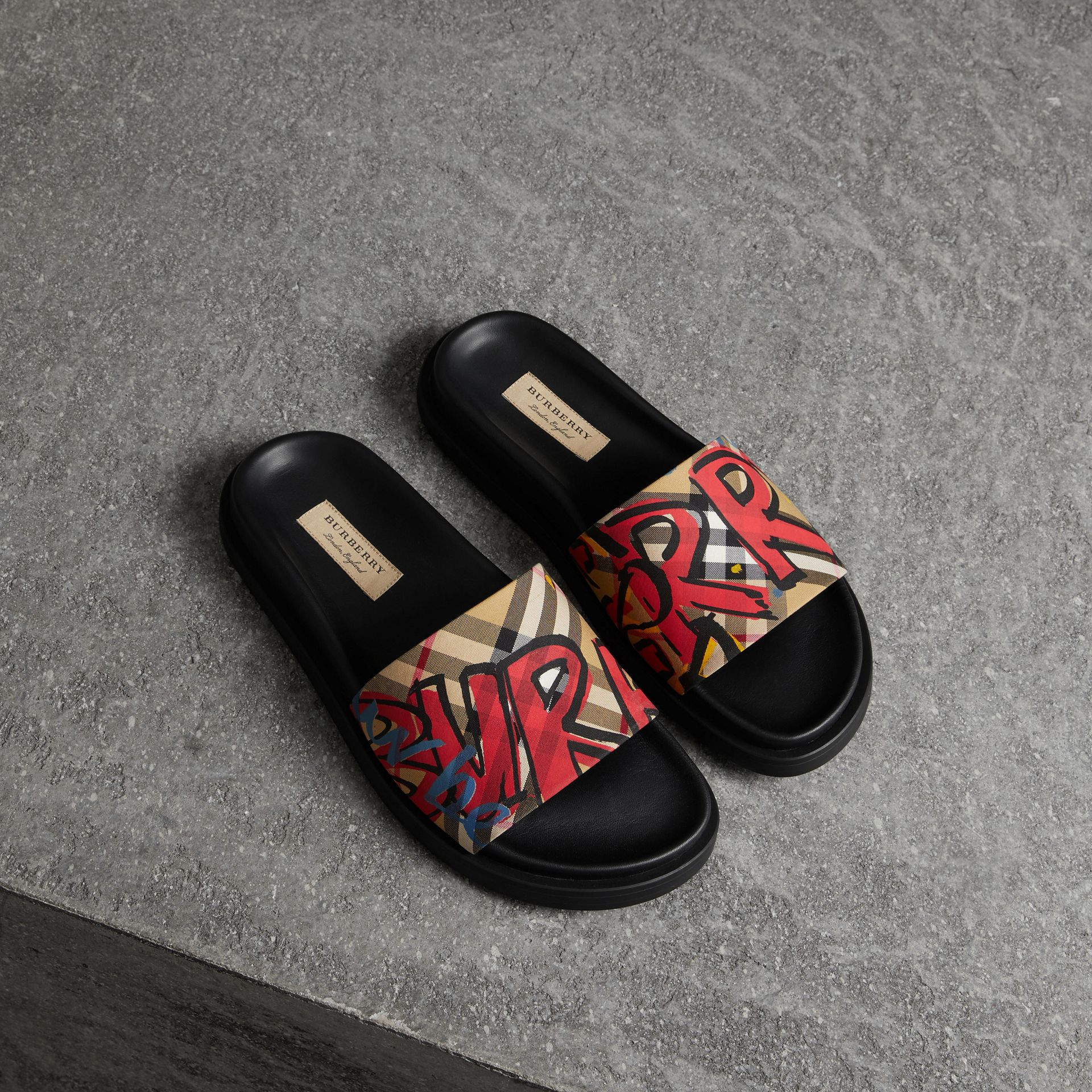 Graffiti Print Vintage Check and Leather Slides in Antique Yellow - Women | Burberry - gallery image 0