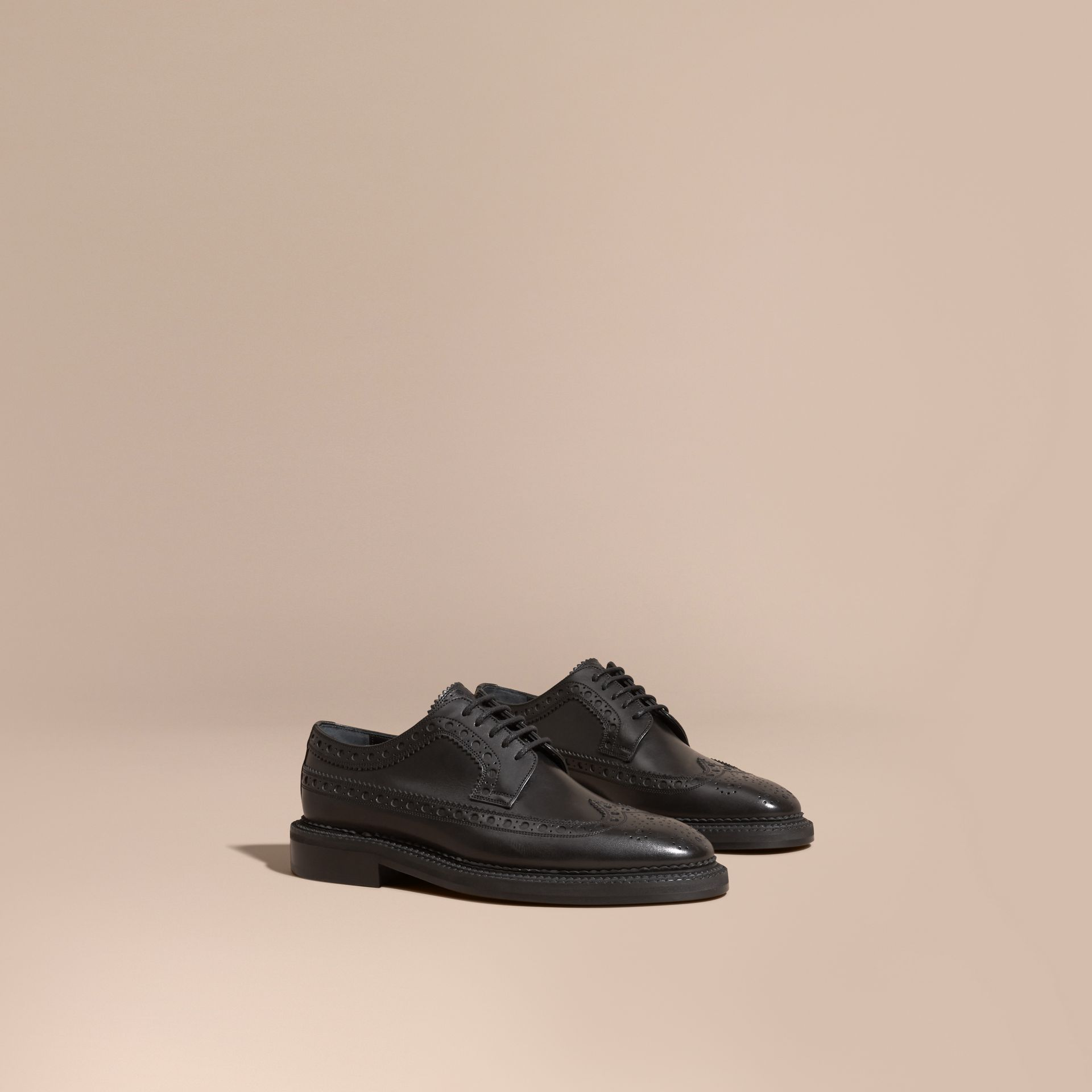 Leather Wingtip Brogues in Black - Men | Burberry - gallery image 1