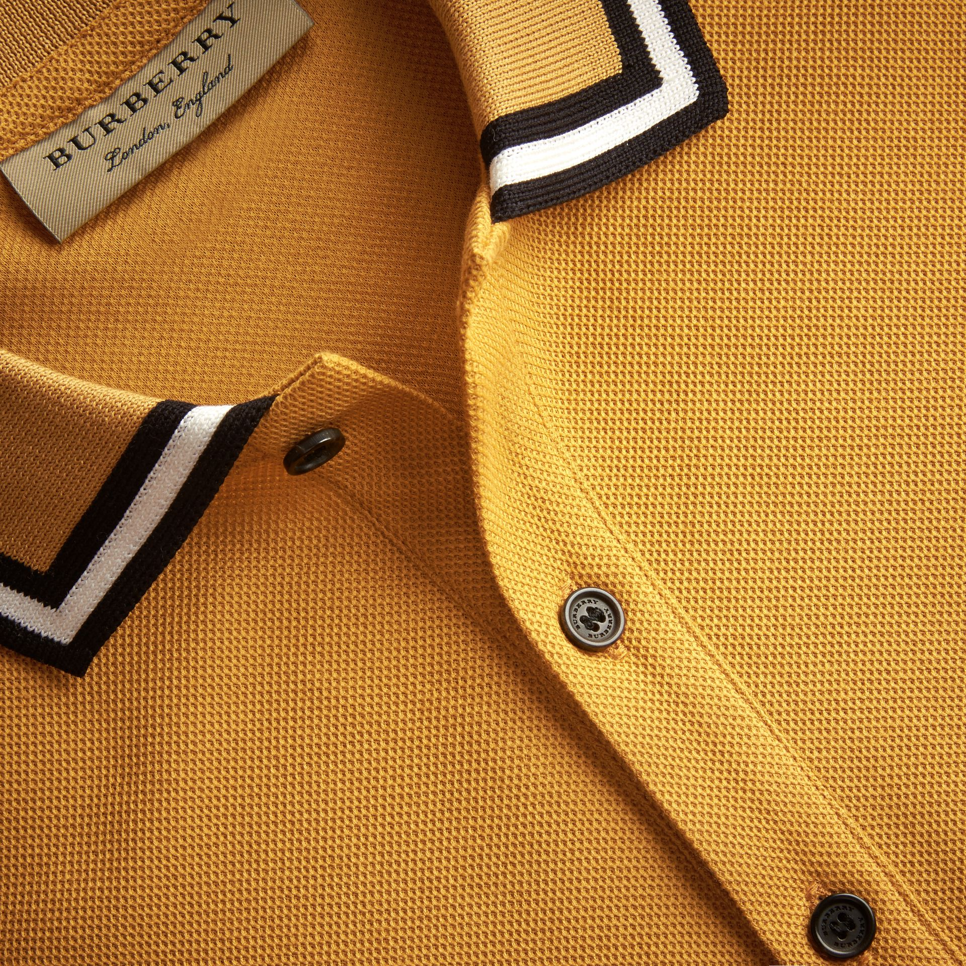 Striped Collar Cotton Piqué Polo Shirt in Saffron Yellow - Men | Burberry - gallery image 2