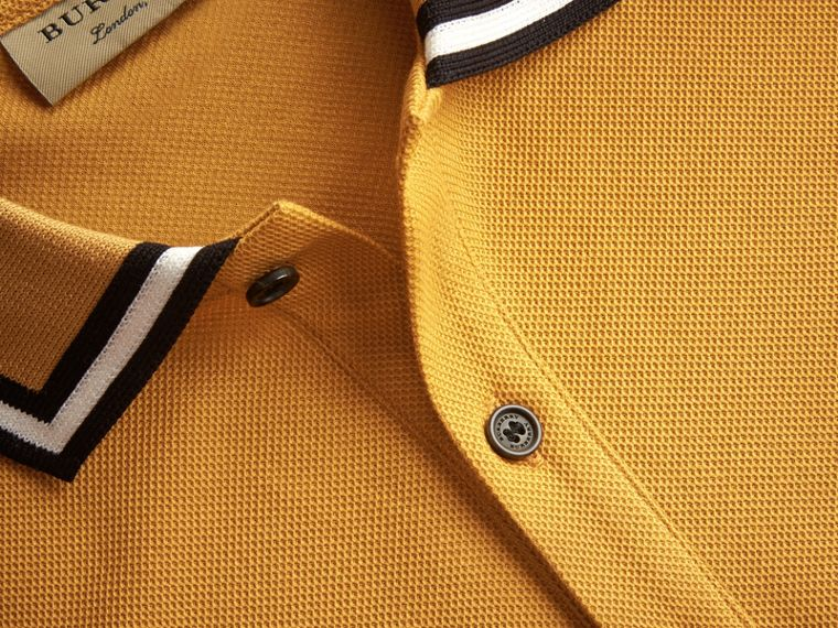 Striped Collar Cotton Piqué Polo Shirt in Saffron Yellow - Men | Burberry Canada - cell image 1