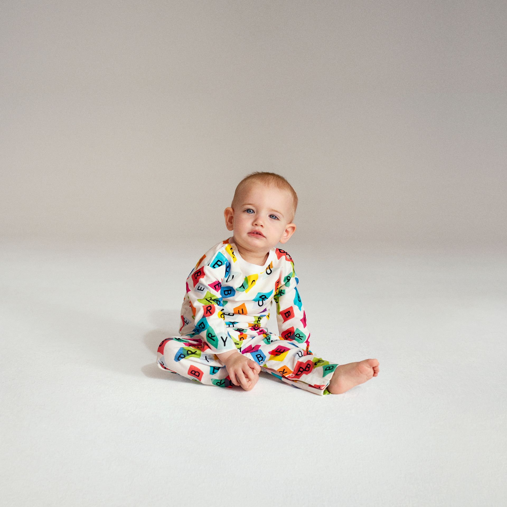 Confetti Letter Print Cotton Jumpsuit in White - Children | Burberry - gallery image 1