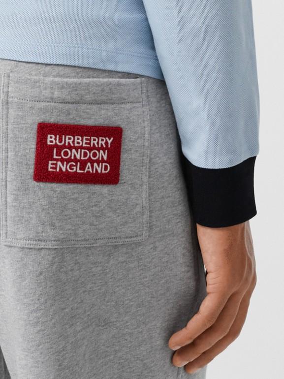 Logo Appliqué Cotton Trackpants in Pale Grey Melange - Men | Burberry United States - cell image 1
