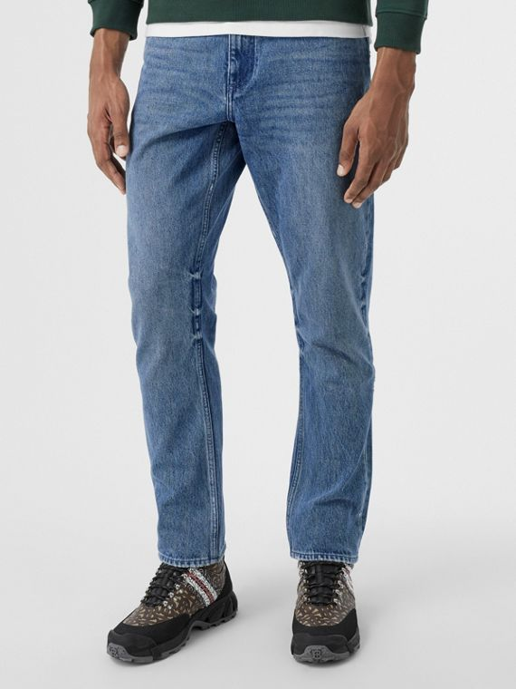 Straight Fit Distressed Denim Jeans in Light Indigo Blue