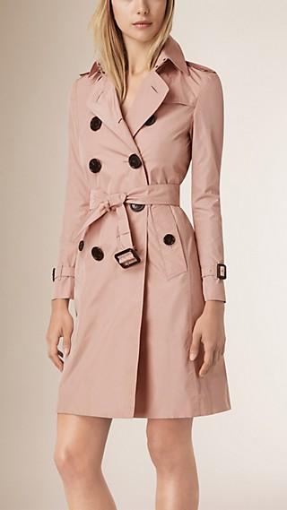 Trench-coat en tissu technique avec garnitures en cuir