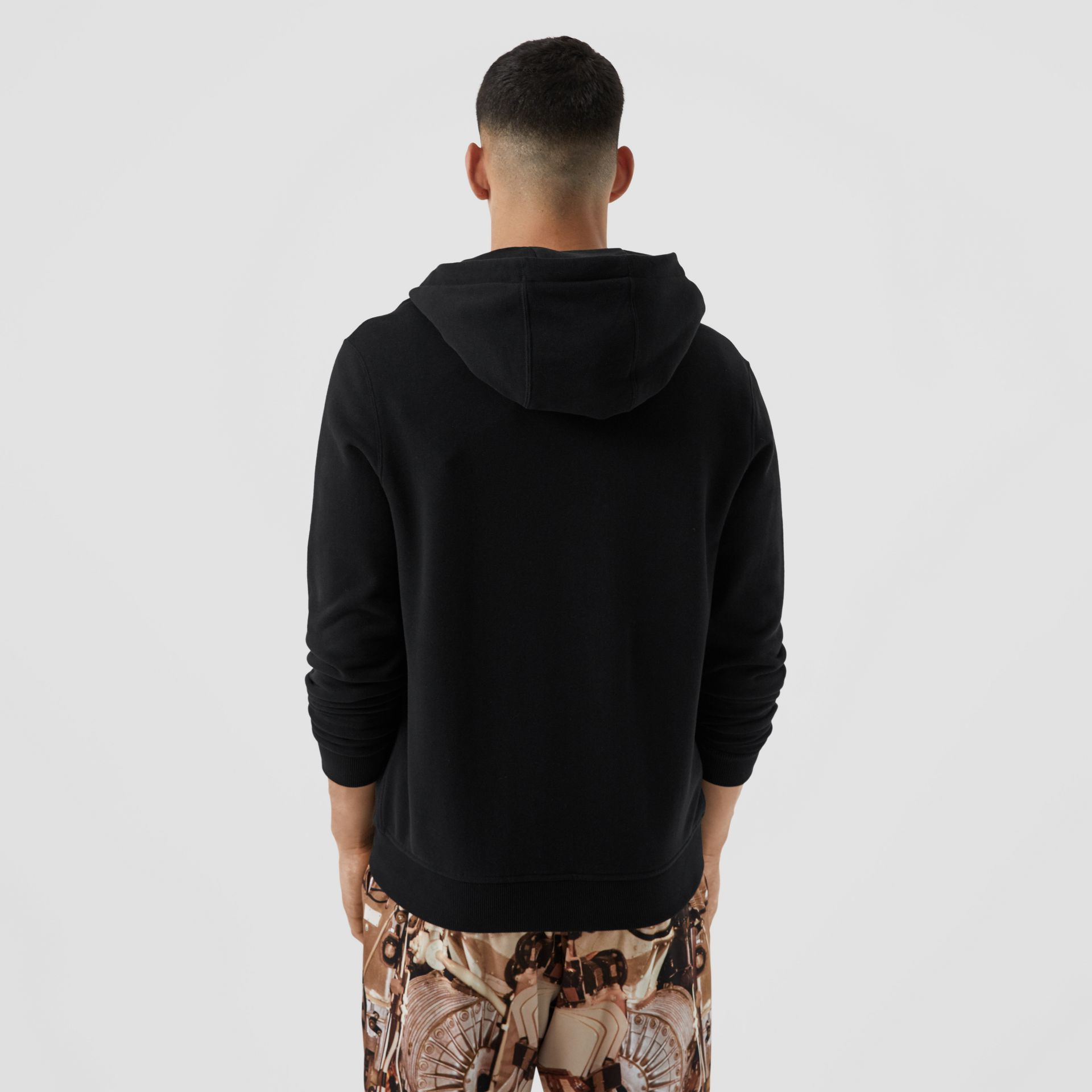 Contrast Logo Graphic Cotton Hooded Top in Black - Men | Burberry - gallery image 2