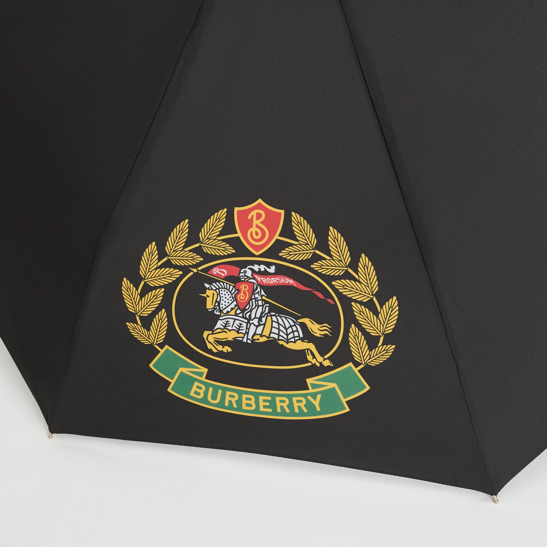 Crest Print Folding Umbrella in Black | Burberry - gallery image 1