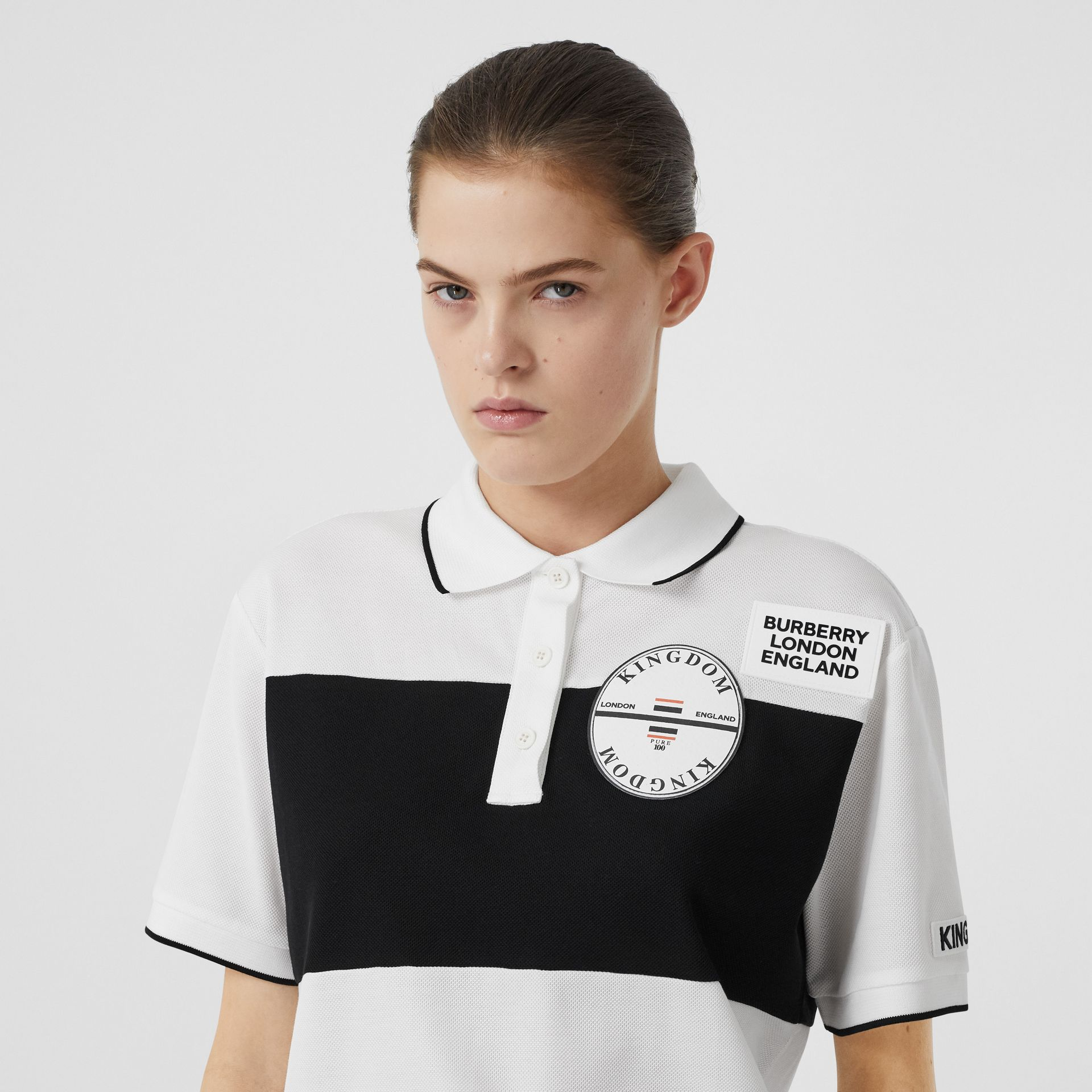 Logo Appliqué Striped Cotton Oversized Polo Shirt in White - Women | Burberry - gallery image 1
