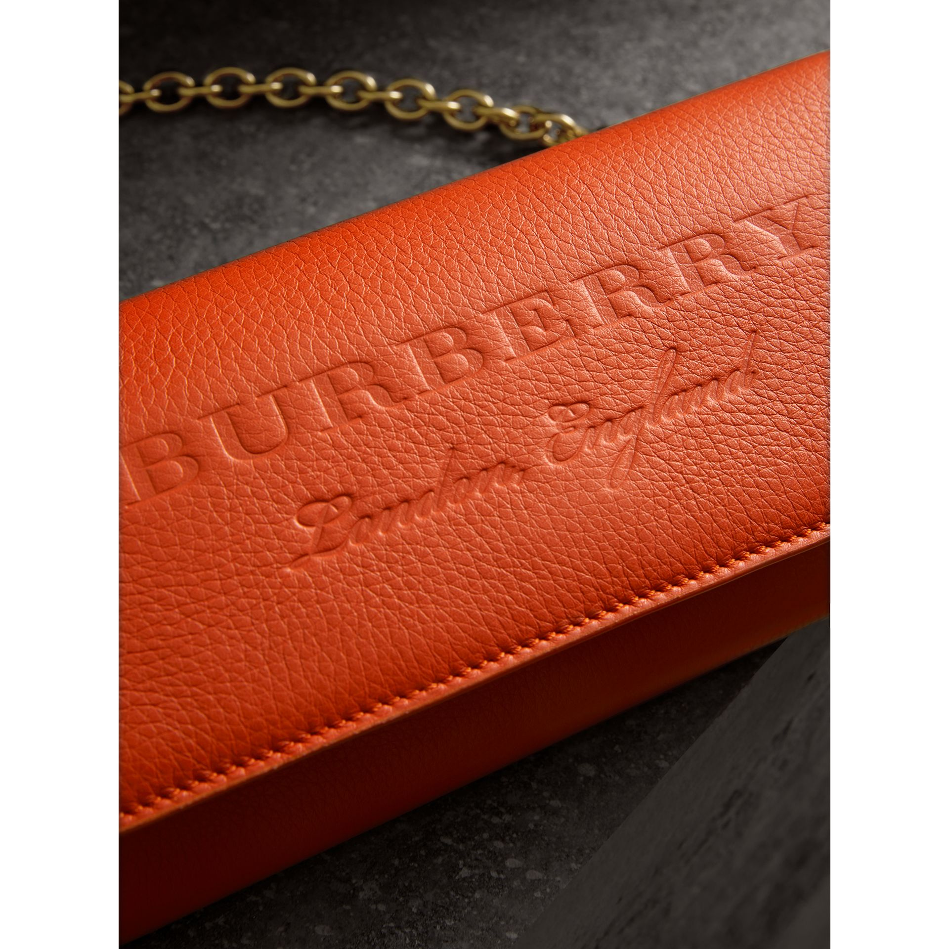 Embossed Leather Wallet with Chain in Dark Clementine - Women | Burberry United Kingdom - gallery image 1