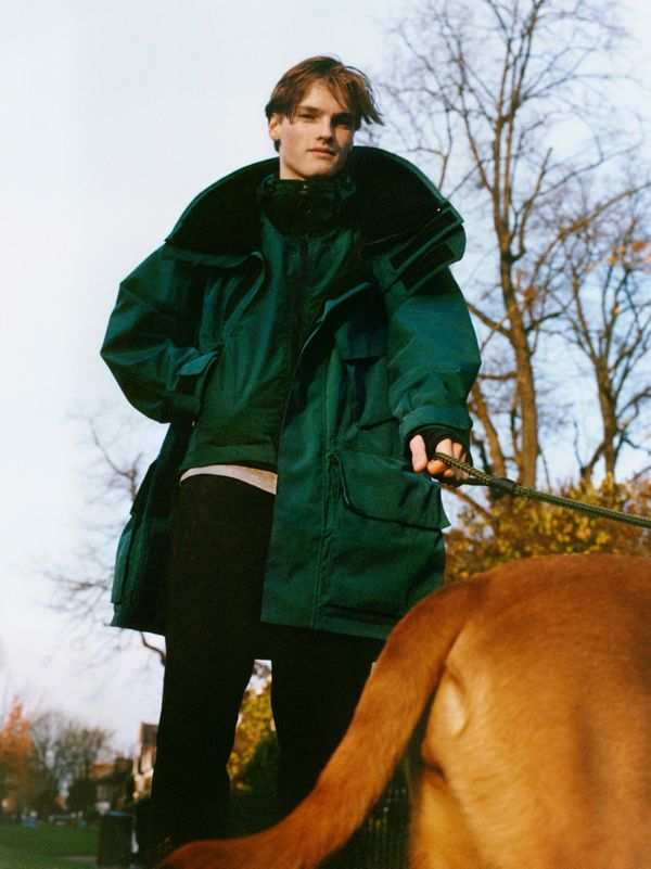 Hugo Hodgson with Lucca<br>Hugo wears a sea-green parka.