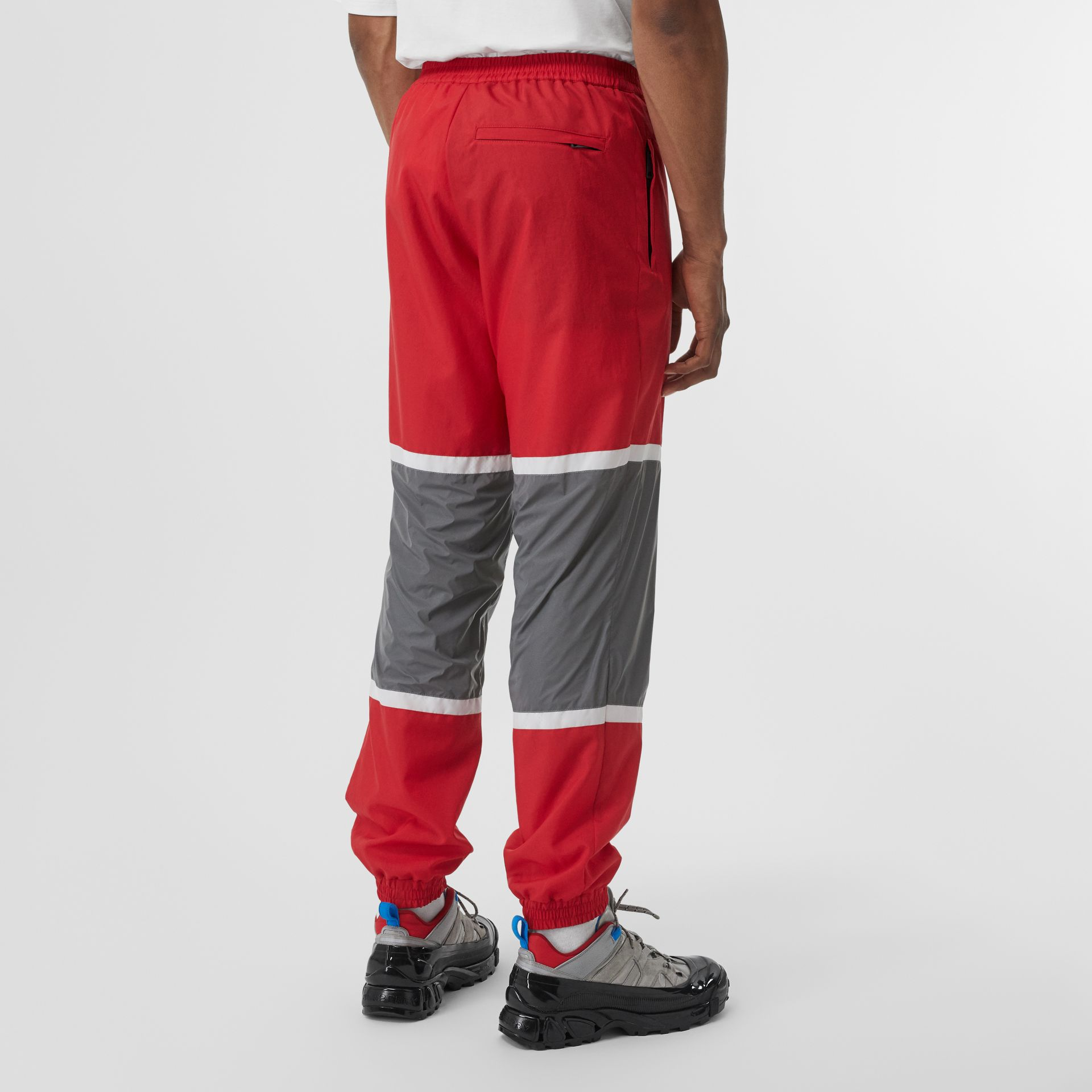 Logo Graphic Striped Nylon Trackpants in Bright Red - Men | Burberry - gallery image 2