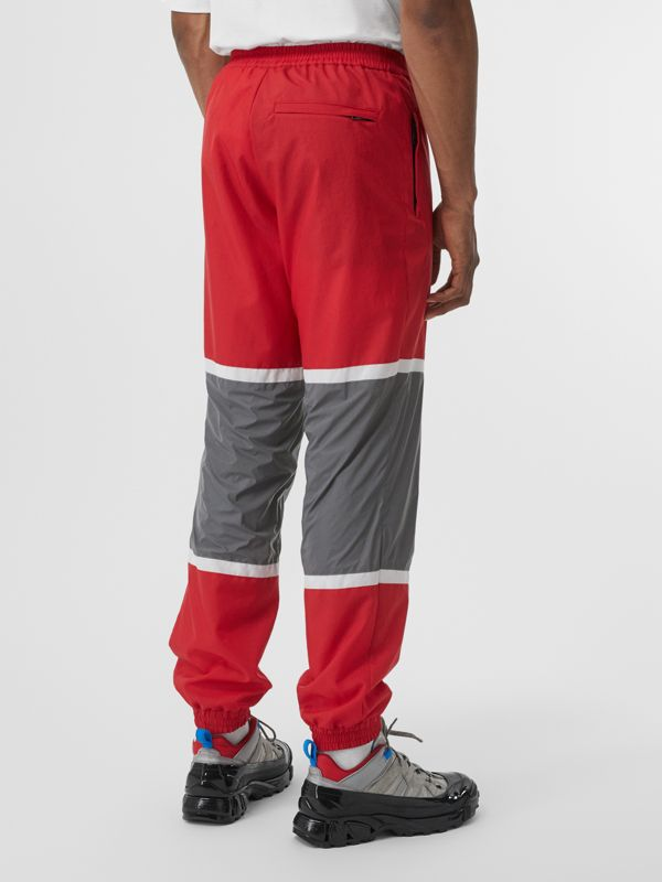 Logo Graphic Striped Nylon Trackpants in Bright Red - Men | Burberry - cell image 2