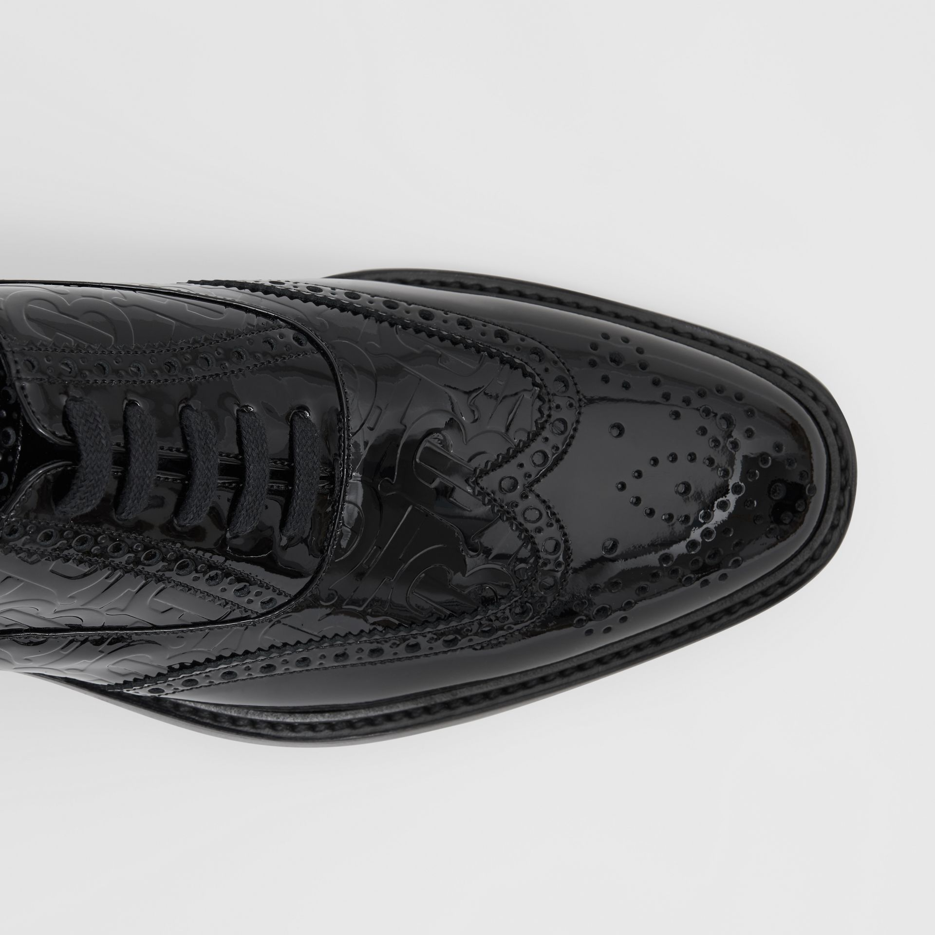 D-ring Detail Monogram Patent Leather Brogues in Black - Men | Burberry Canada - gallery image 1
