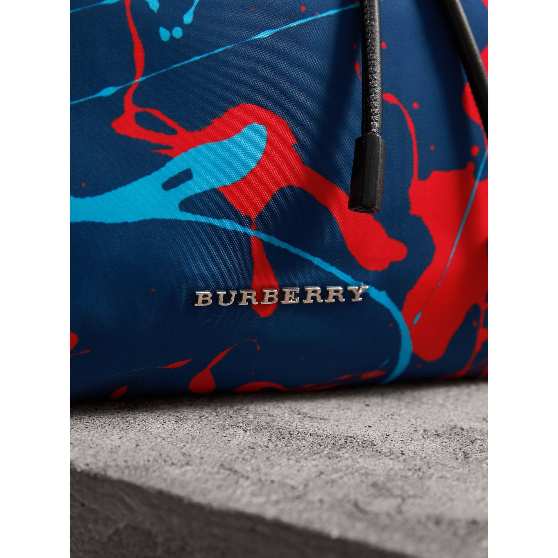 The Large Rucksack in Splash Print in Navy/orange - Men | Burberry United Kingdom - gallery image 1