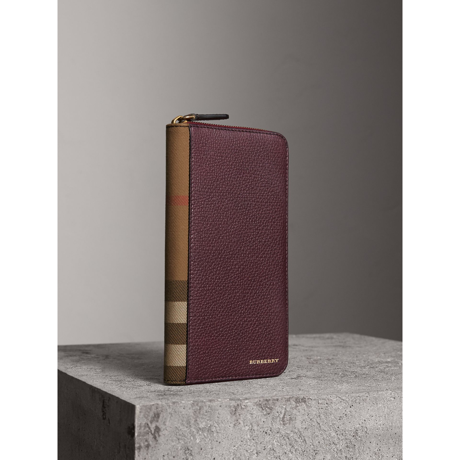 House Check and Grainy Leather Ziparound Wallet in Wine | Burberry - gallery image 1