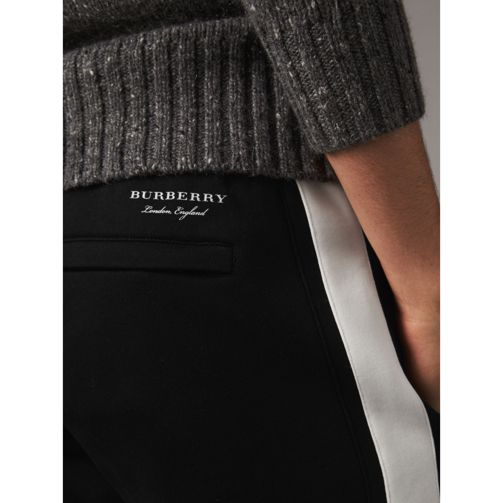 Bold Stripe Detail Cotton Blend Sweatpants in Black - Men | Burberry Hong Kong - gallery image 2