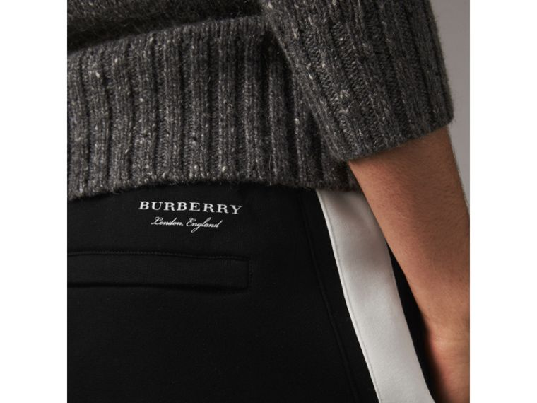 Bold Stripe Detail Cotton Blend Sweatpants in Black - Men | Burberry - cell image 1