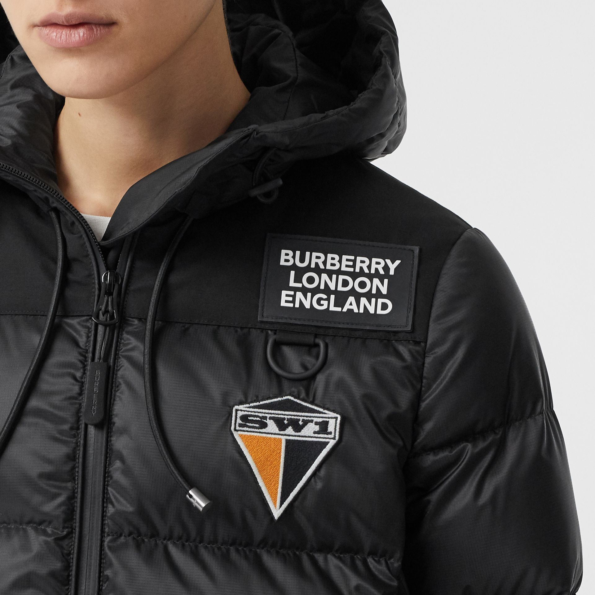 Logo Graphic Hooded Puffer Jacket in Black - Women | Burberry - gallery image 1