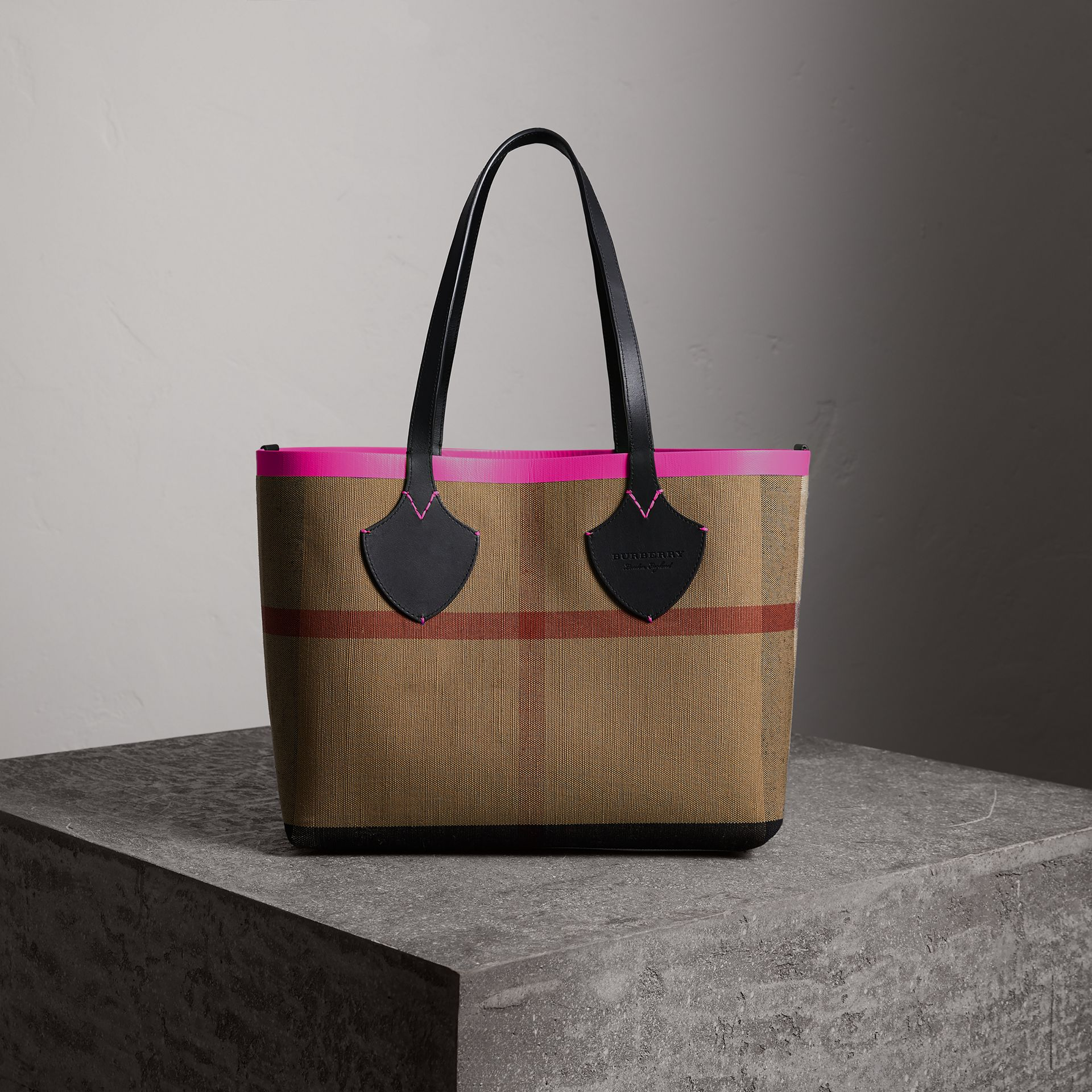The Medium Giant Reversible Tote in Canvas and Leather in Black/neon Pink | Burberry - gallery image 1