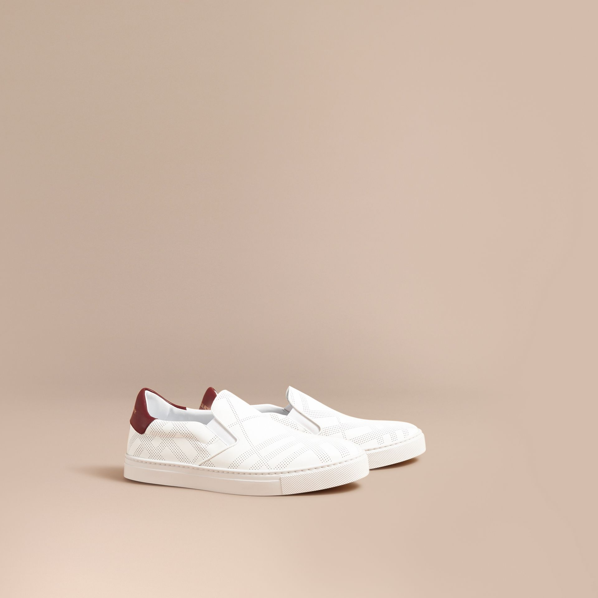 Perforated Check Leather Slip-on Trainers in Optic White/deep Claret Melange - Men | Burberry - gallery image 1