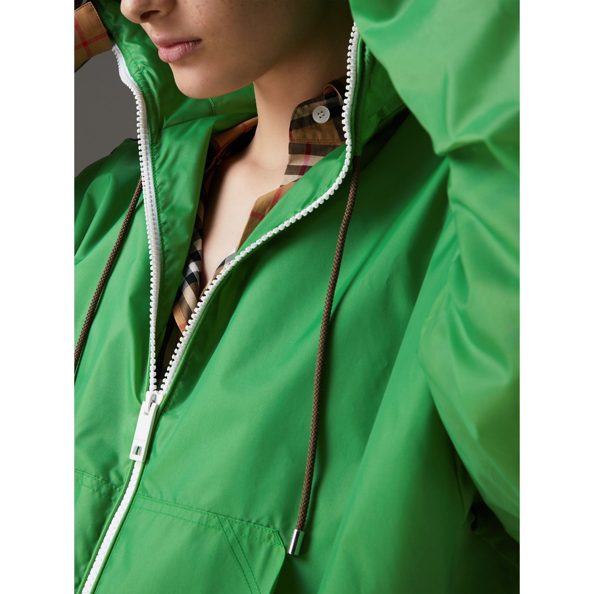 Stripe Detail Showerproof Hooded Jacket in Bright Pigment Green - Women | Burberry Canada - gallery image 1