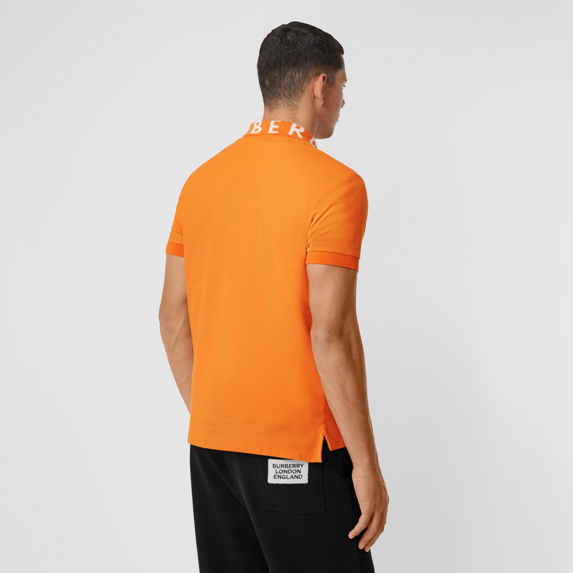 Polo in cotone piqué con logo a intarsio (Arancione Intenso) - Uomo | Burberry - immagine della galleria 2
