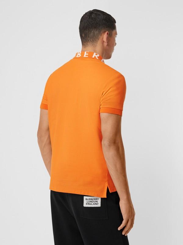 Polo in cotone piqué con logo a intarsio (Arancione Intenso) - Uomo | Burberry - cell image 2