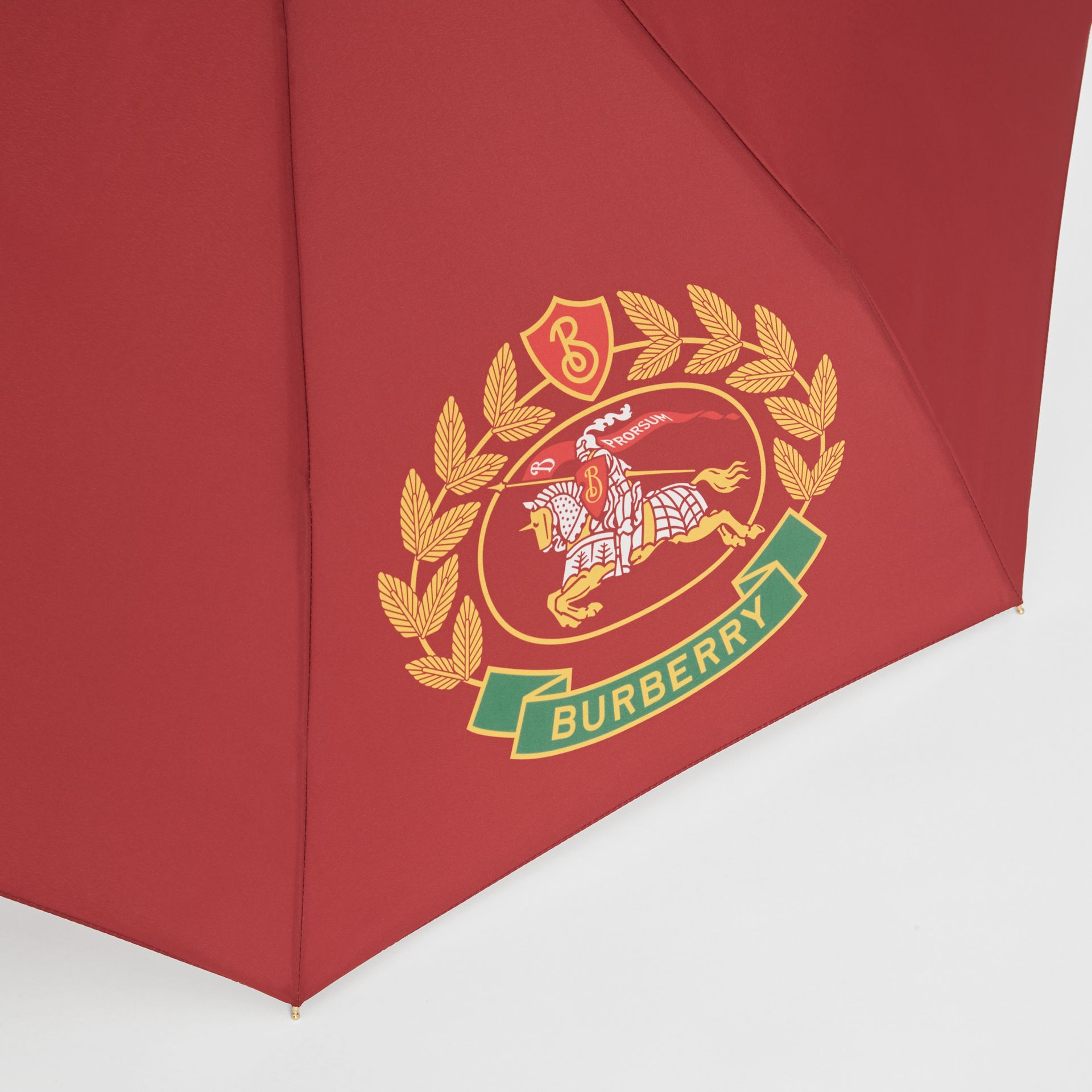 Crest Print Folding Umbrella in Claret | Burberry - gallery image 1