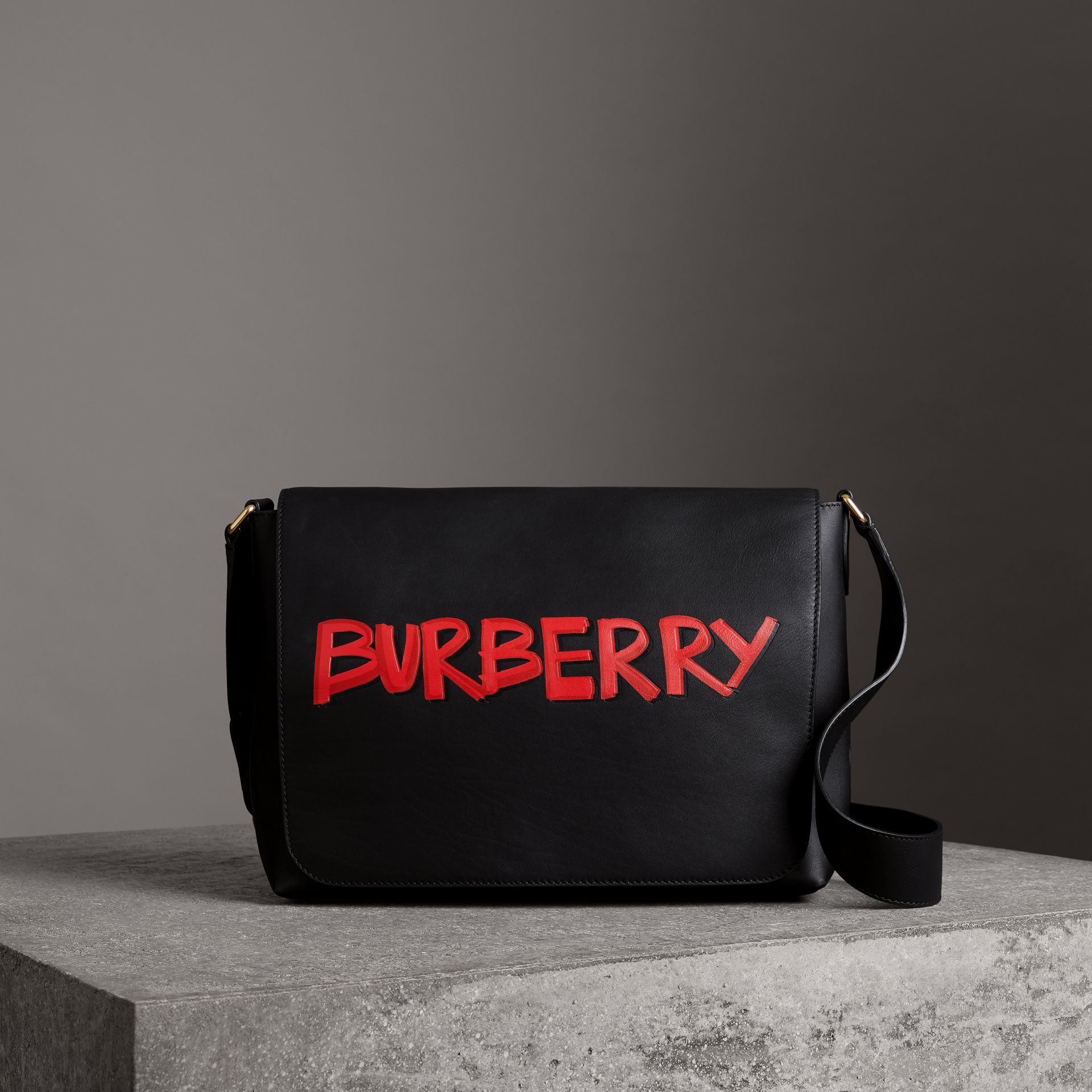 Large Graffiti Print Leather Messenger Bag in Black - Men | Burberry - gallery image 0