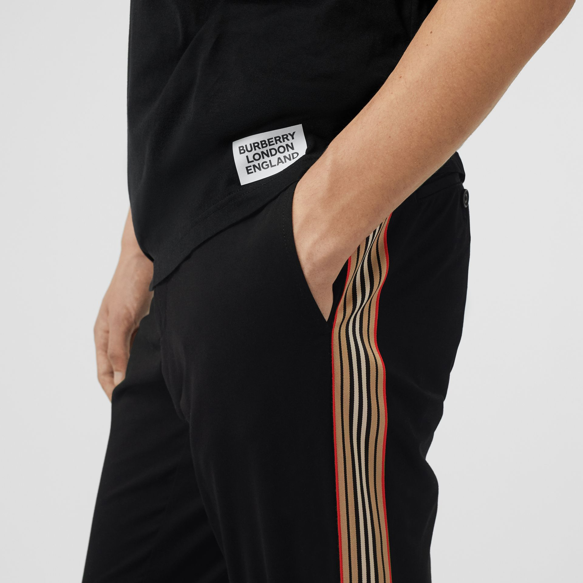 Slim Fit Icon Stripe Detail Cotton Chinos in Black - Men | Burberry - gallery image 1