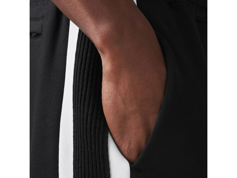 Stripe Detail Cotton Blend Jersey Sweatpants in Black - Men | Burberry United Kingdom - cell image 1