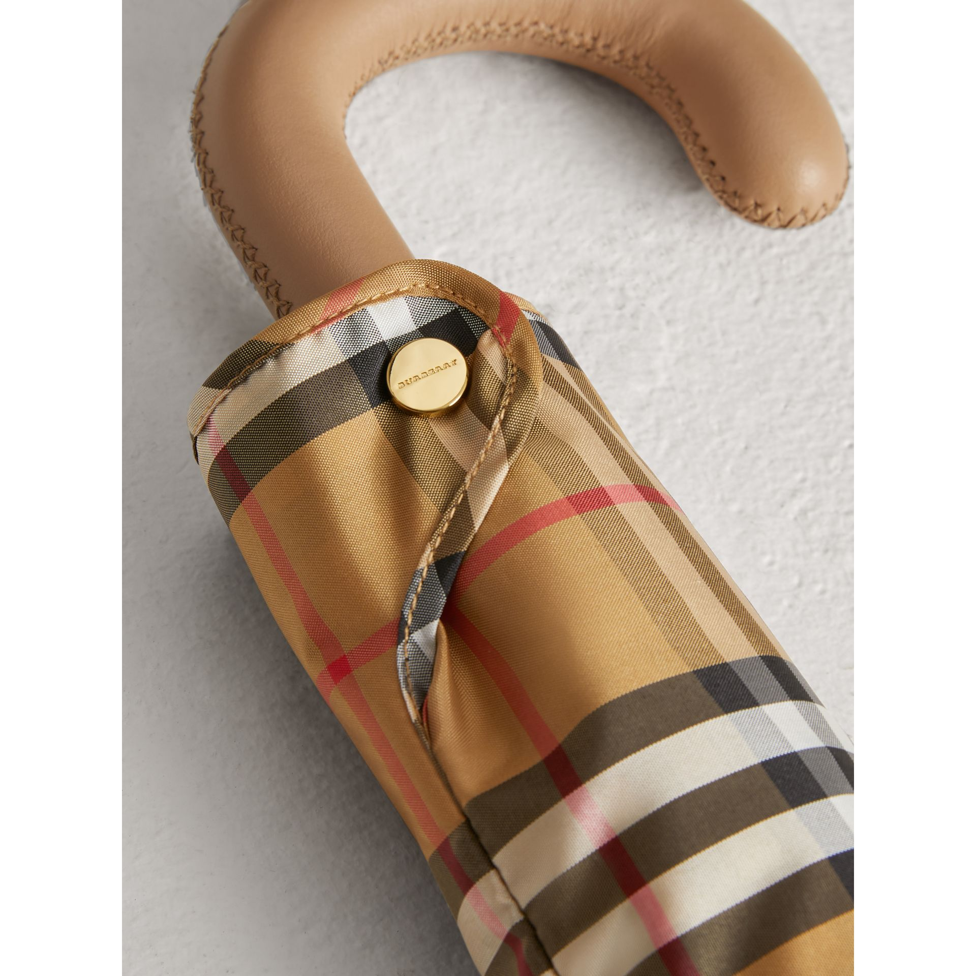 Vintage Check Folding Umbrella in Antique Yellow/honey | Burberry United Kingdom - gallery image 1