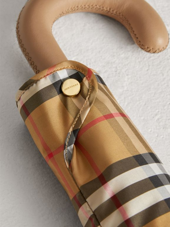 Vintage Check Folding Umbrella in Antique Yellow/honey | Burberry United Kingdom - cell image 1