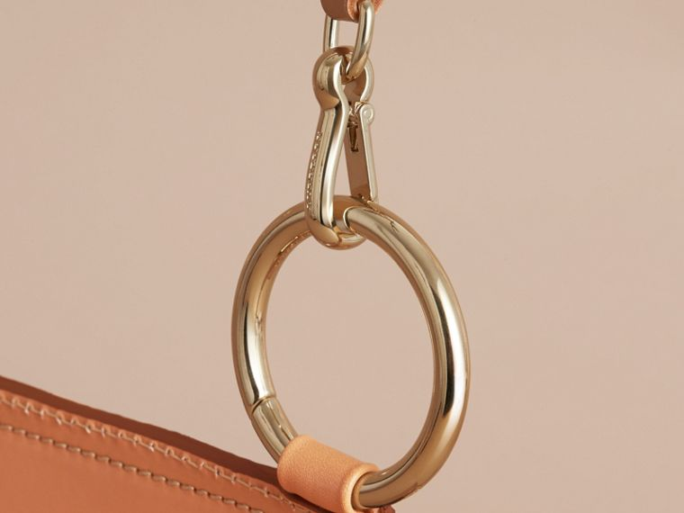 The Bridle Bag in Fruit and Flowers Riveted Leather in Pale Clementine - cell image 1