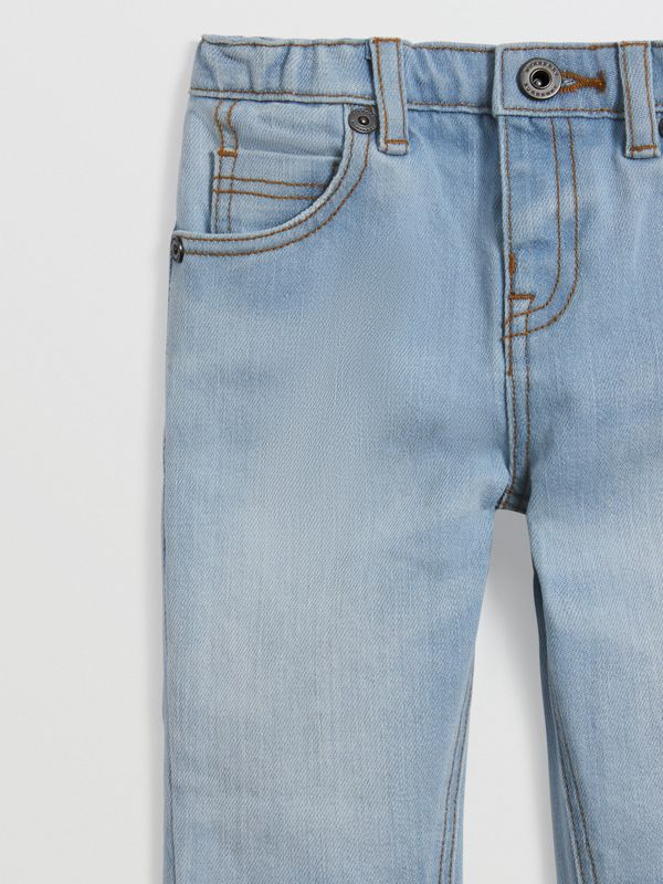 Relaxed Fit Stretch Jeans in Light Blue - Children | Burberry United States - cell image 3