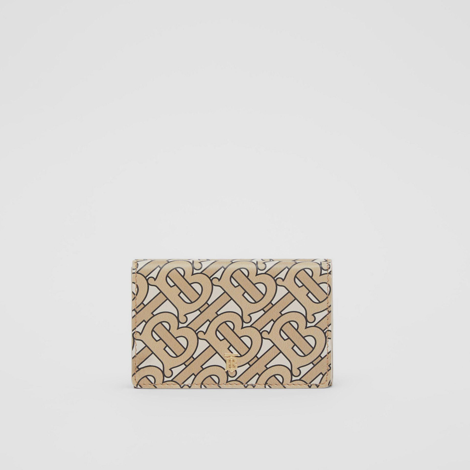 Small Monogram Print Leather Folding Wallet in Beige | Burberry United Kingdom - gallery image 0
