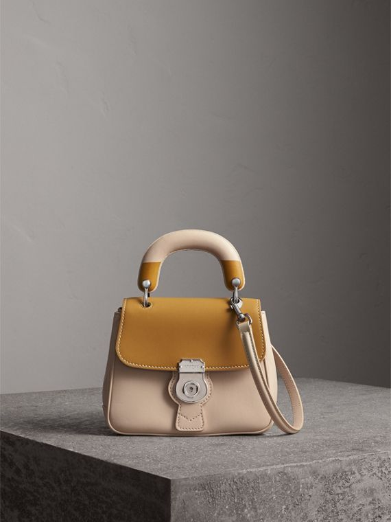 The Small DK88 Top Handle Bag with Geometric Print in Limestone/ochre Yellow