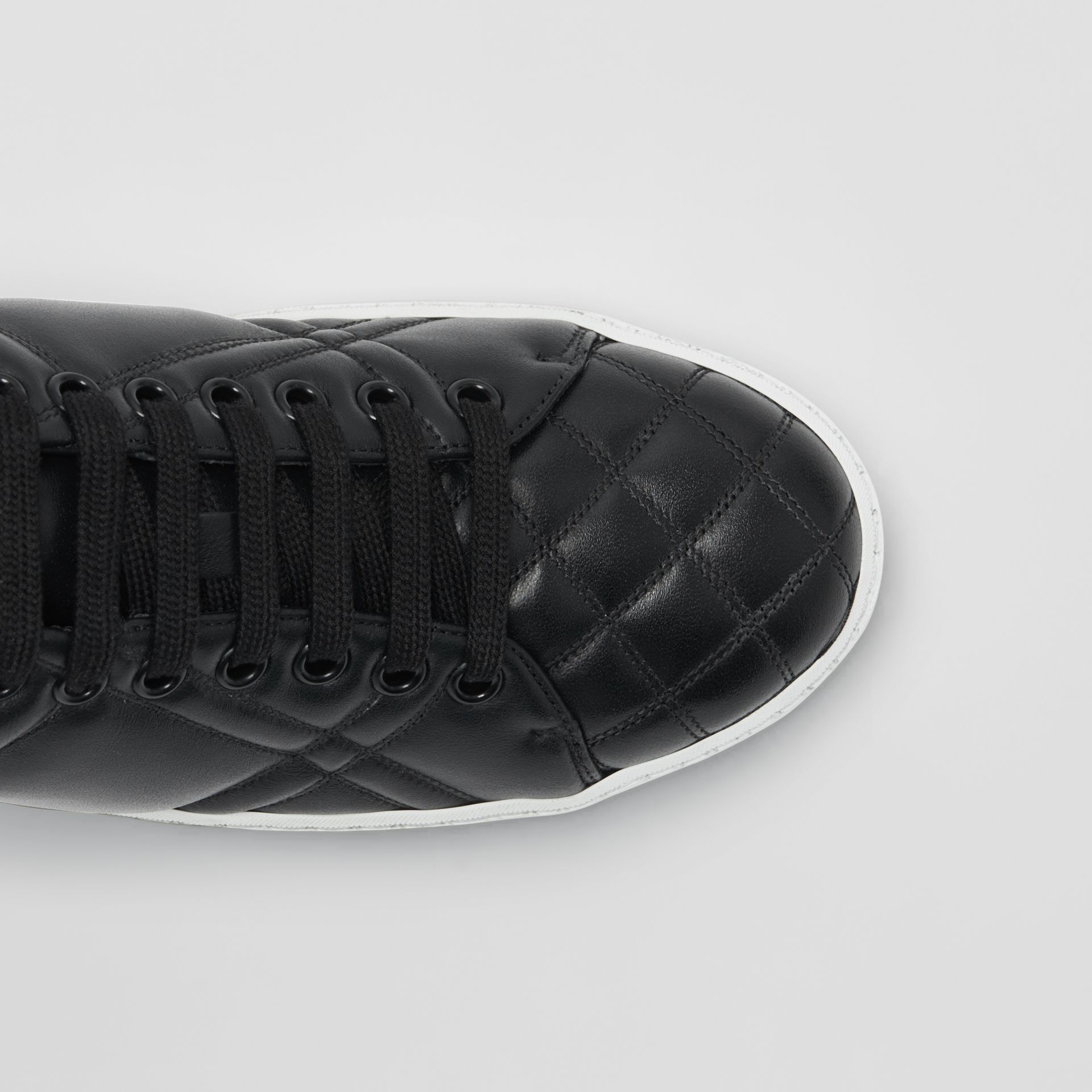 Check-quilted Leather Sneakers in Black - Women | Burberry Canada - gallery image 1
