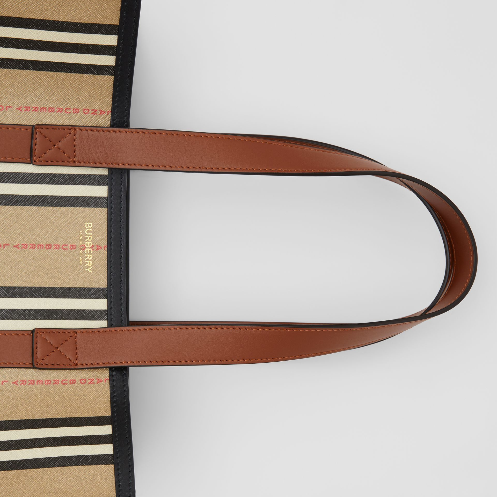 Logo and Stripe E-canvas Portrait Tote Bag in Tan/archive Beige - Women | Burberry Hong Kong S.A.R - gallery image 1