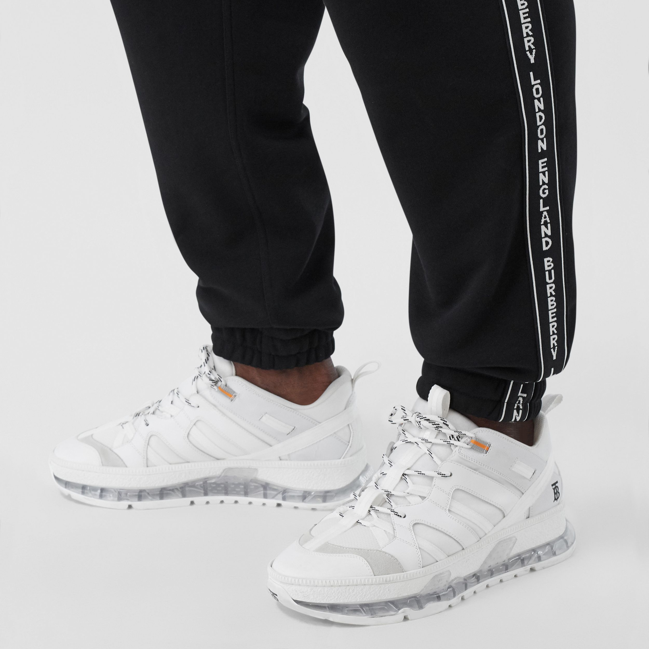 Logo Tape Cotton Jogging Pants in Black - Men | Burberry Singapore - 2