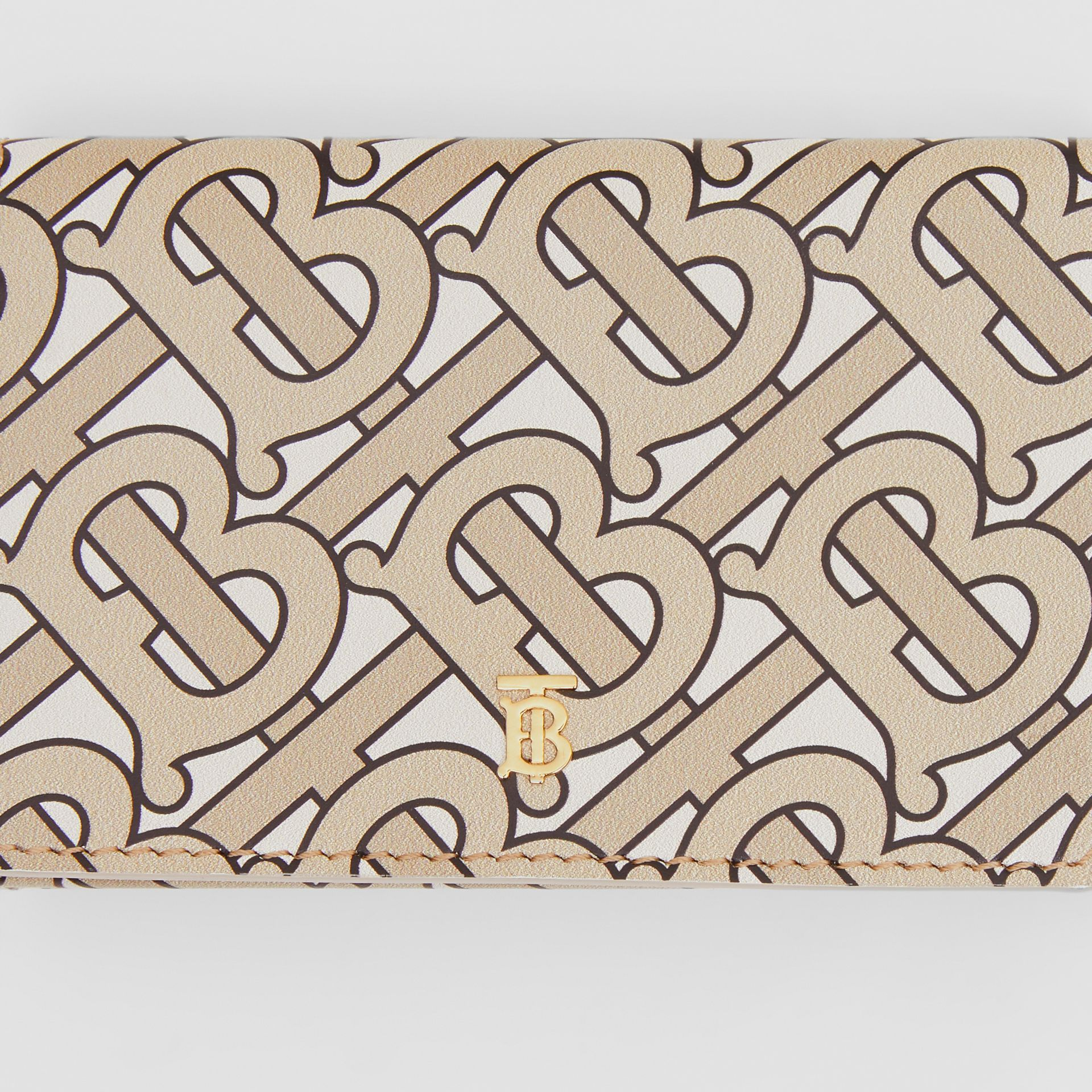 Small Monogram Print Leather Folding Wallet in Beige - Women | Burberry United Kingdom - gallery image 1