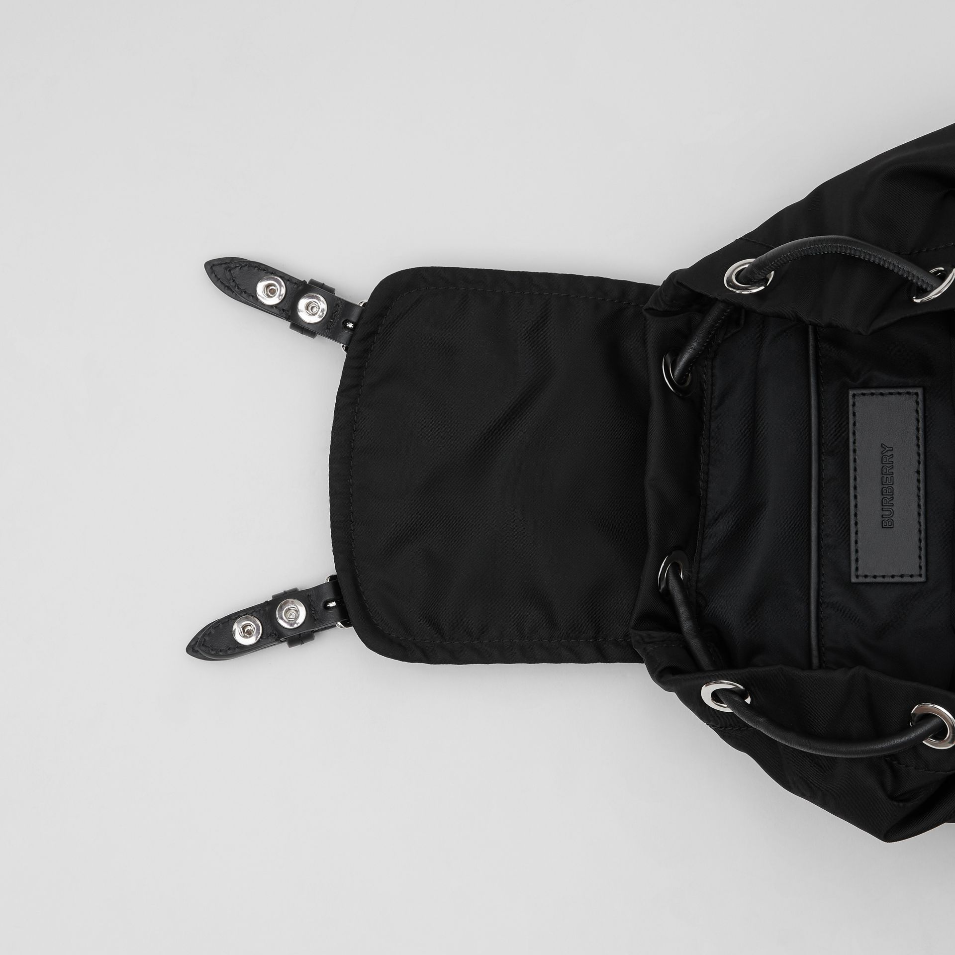 The Small Rucksack in Logo Print ECONYL® in Black - Women | Burberry United Kingdom - gallery image 4