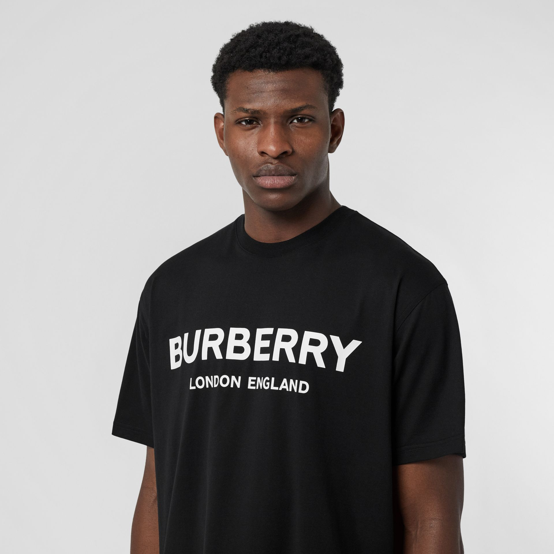 Logo Print Cotton T-shirt in Black - Men | Burberry United Kingdom - gallery image 1