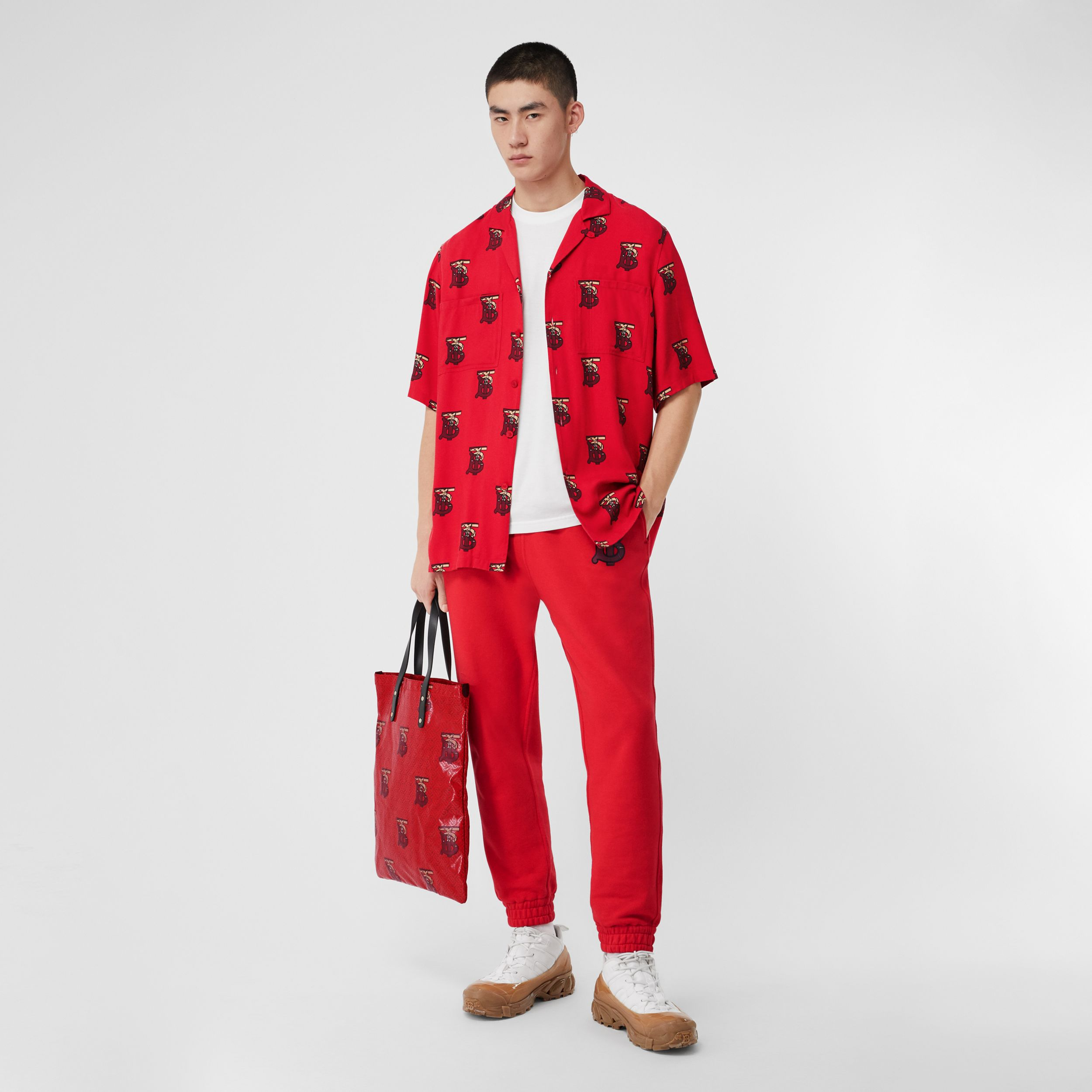 Monogram Motif Cotton Trackpants in Bright Red - Men | Burberry Australia - 1