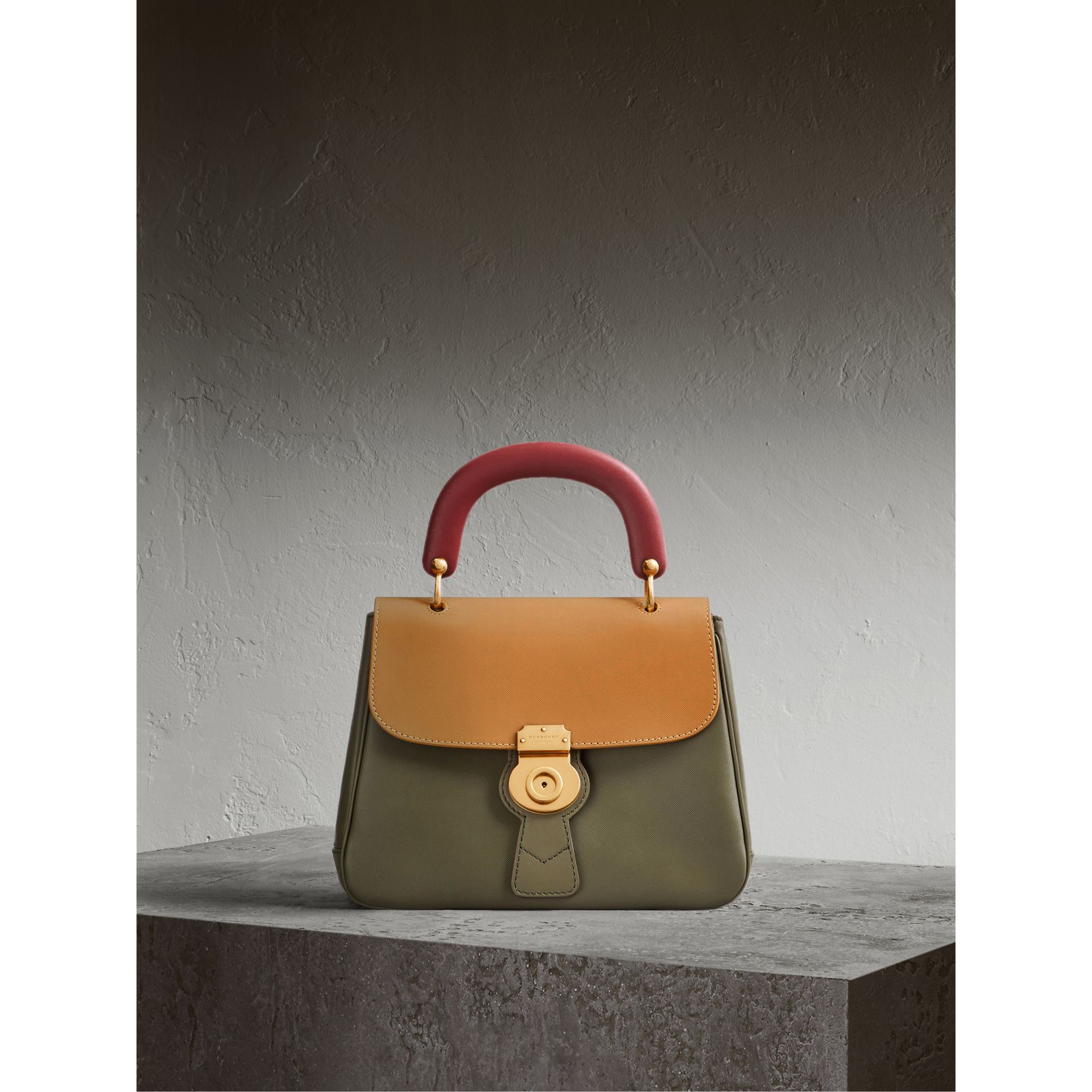 The Medium DK88 Top Handle Bag in Moss Green/ochre Yellow - gallery image 1