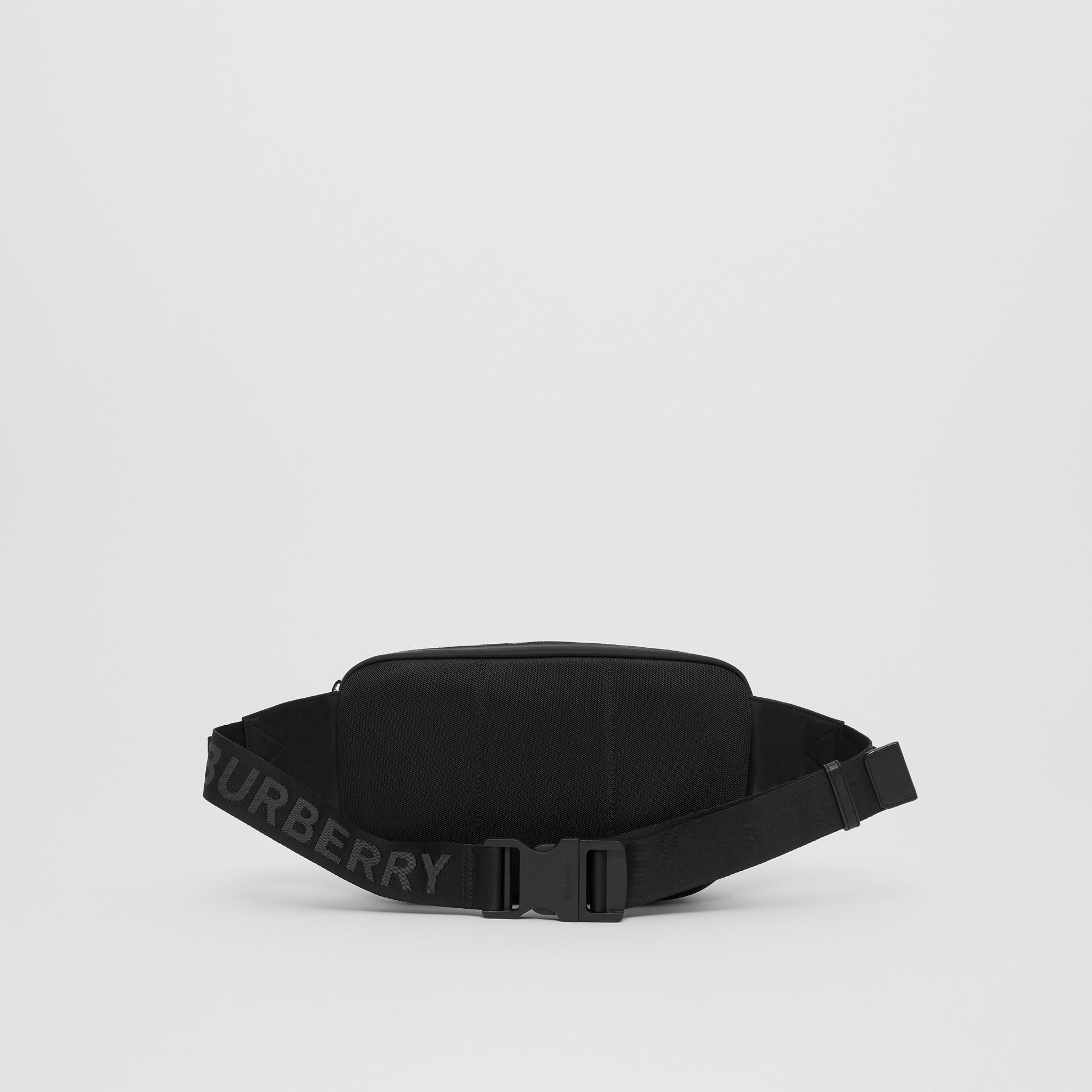 Medium Logo Print ECONYL® Cannon Bum Bag in Black - Men | Burberry United Kingdom - gallery image 9