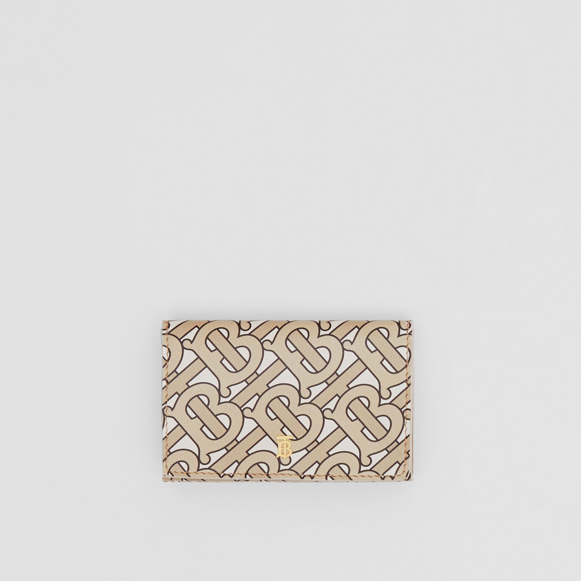 Small Monogram Print Leather Folding Wallet in Beige - Women | Burberry United Kingdom - gallery image 0