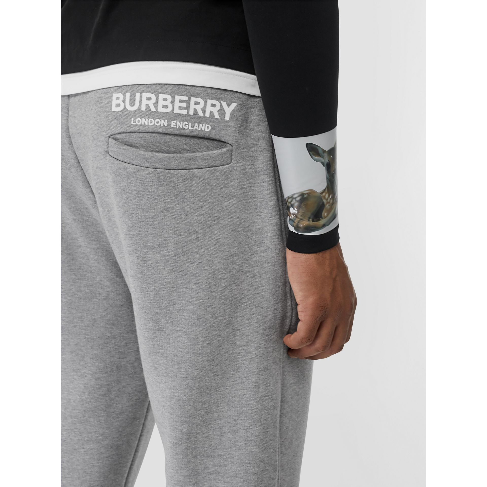 Logo Print Cotton Trackpants in Pale Grey Melange - Men | Burberry - gallery image 1